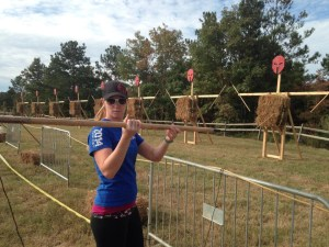Muddy Mommy throwing a spear at a Spartan Race (photo courtesy of Muddy Mommy)
