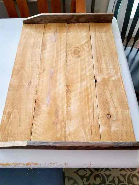 Learn how to make your own DIY Noodle Board for less than $10 with this easy to follow tutorial. Add more usable space in your kitchen with this farmhouse stove topper! | We Three Shanes