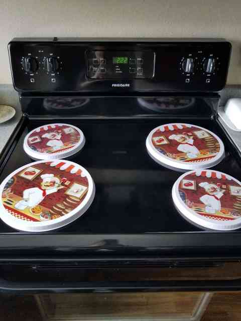 Using burner covers will help protect your stove from your DIY noodle board | We Three Shanes