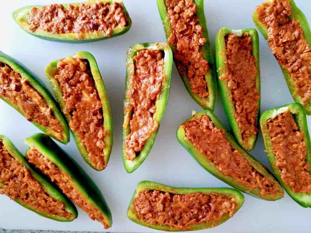 Looking for an easy appetizer recipe for your next barbecue? Stuffed jalapeno poppers are a must! Fresh jalapenos are filled with chorizo and cheese then wrapped with bacon and grilled to crispy perfection. These poppers are seriously addicting, making them a summertime cookout crowd pleaser. | We Three Shanes