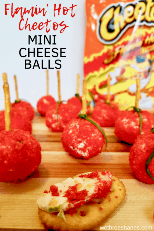 Mini Cheese Ball Bites are the perfect snack on a stick. Flamin' Hot Cheetos add some kick & color to this popular appetizer. Making them a beautiful and tasty treat for your next gathering. | We Three Shanes