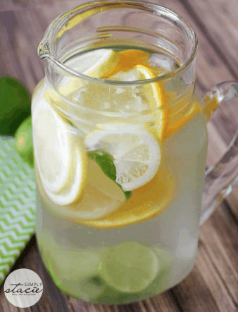 Citrus Bliss Infused Water is a refreshing way to stay hydrated this Summer. Check out this recipe and 16 other Flavored Water Recipes by clicking the link! | We Three Shanes