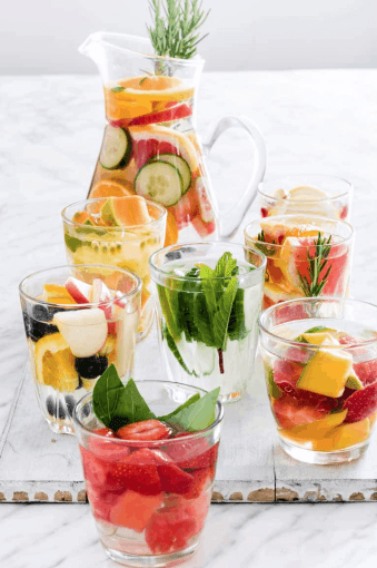 Enjoy water more by infusing it with your favorite fruits, veggies, herbs, and spices. We've got 17 delicious Naturally Flavored Water Recipes for you try. It's the perfect Summer treat. Stay Hydrated!