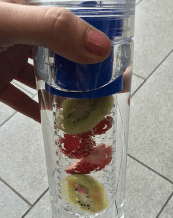 Raspberry Kiwi Strawberry Infused Water is a refreshing way to stay hydrated this Summer. Check out this recipe and 16 other Flavored Water Recipes by clicking the link! | We Three Shanes