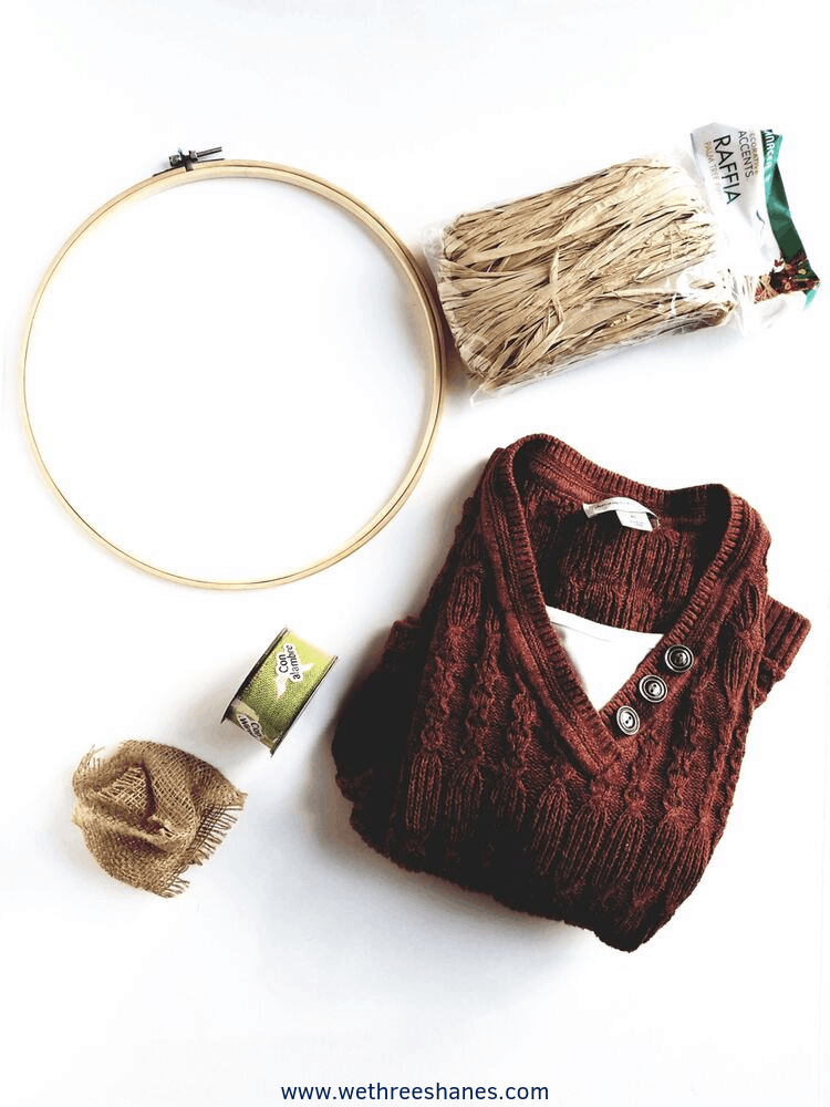Create your own cozy upcycled sweater Pumpkin Hoop Wreath with this easy to follow tutorial. The perfect Fall decor for your wall or door. It's budget friendly and comes together in minutes. | We Three Shanes