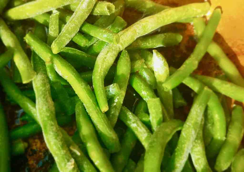Frozen green beans are great when sauteed with bacon, garlic, and slivered almonds. It's a delicious side dish that easy to make for week night dinners but fancy enough for Holiday dinners. | We Three Shanes