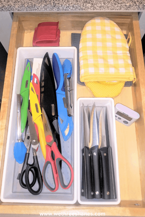 Drowning in stuff? Learn this simple decluttering system to keep your home organized and clutter free! Spend less time cleaning & more time doing what you love! | We Three Shanes