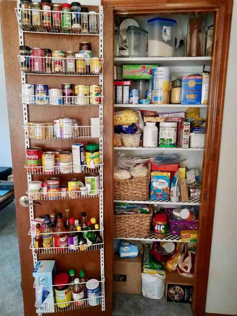Picture of my messy, small pantry before I organized it. See the after photo and get tips for creating an organized pantry on a budget. | We Three Shanes