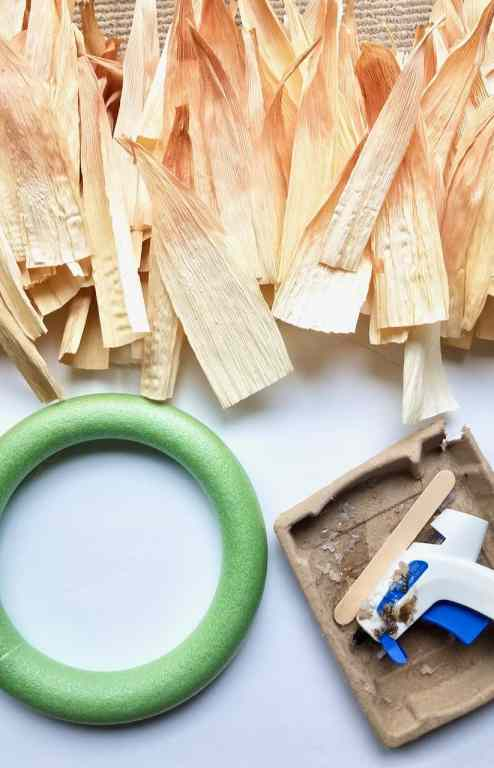 Once corn husks are dyed and dry, it's time to grab your wreath form and glue gun so you can make the wreath.