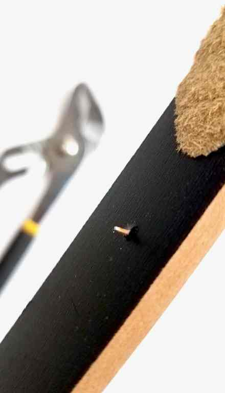 Showing your how to remove a nails left in the stick using pliers.
