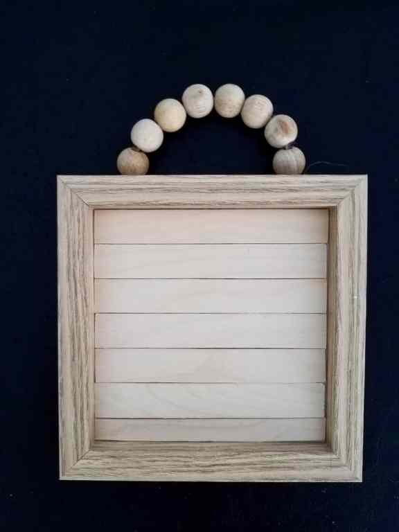 Give a wood bead sign an upgrade with some paint, popsicle sticks, and some dollar store calendars. | We Three Shanes
