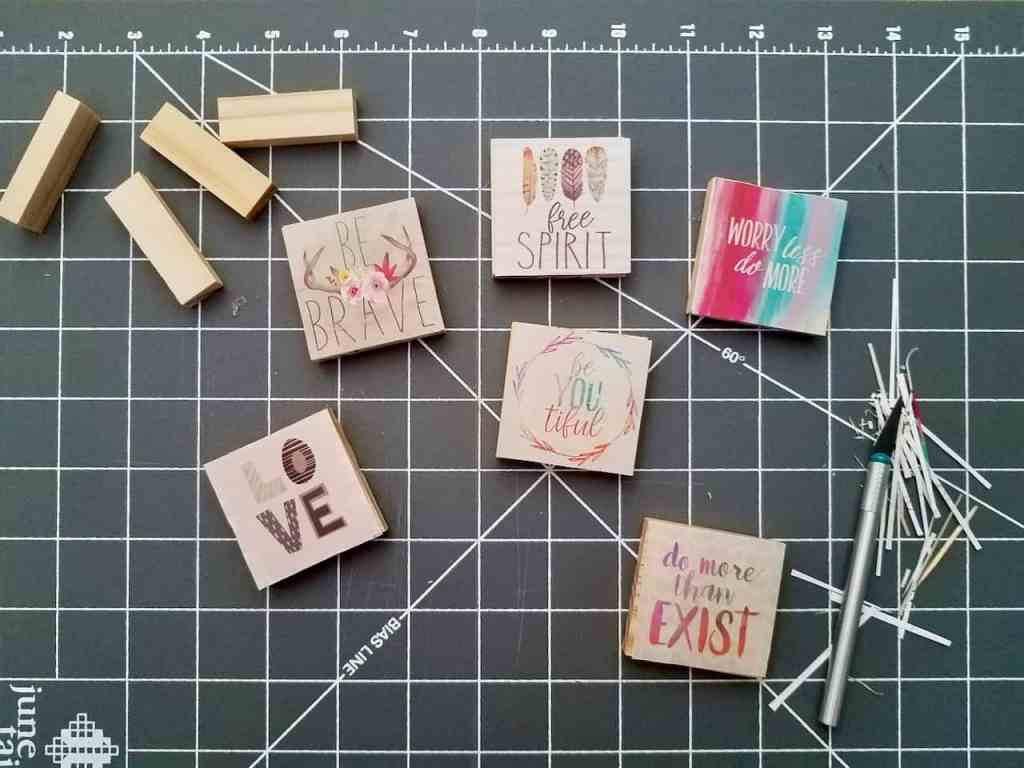 Use Dollar Tree jenga blocks and calendars to make the cutest magnets and ornaments. A super easy craft that makes great DIY gifts.