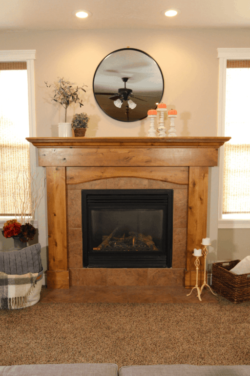 Learn these simple tips and tricks for decorating your fireplace mantel like a professional while still showing off your personal style. | We Three Shanes
