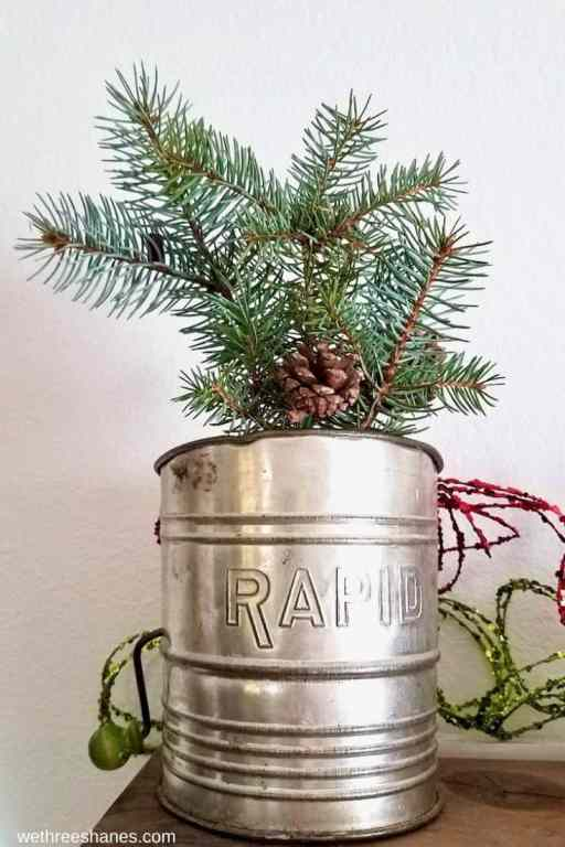 Use natural elements from your yard to make everyday items, that you already own, into simple Christmas decor.   We Three Shanes