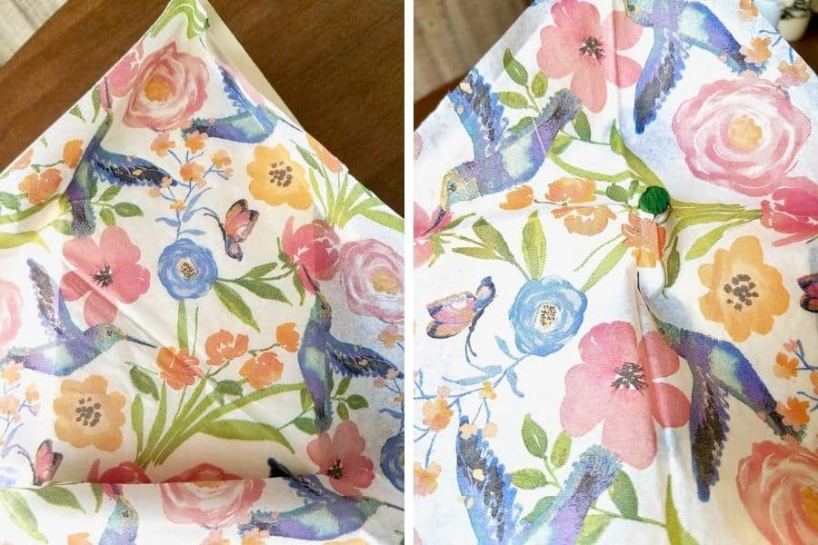 Photo on the left shows a napkin with pink, orange, and blue wild flowers and blue hummingbirds laid over the birdhouse so it can be cut to size. A photo on the right shows the perch from the birdhouse poking through the napkin.