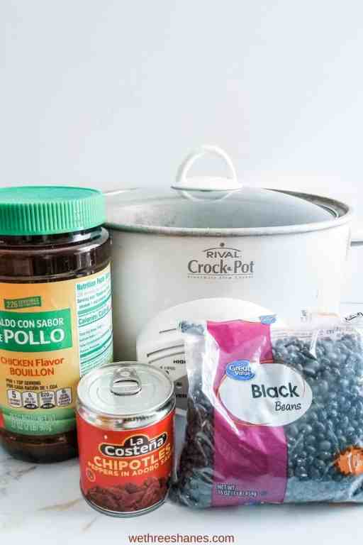 The crockpot, chicken bouillon, canned chipotle peppers, dried black beans pictured here are all you need for delicious, homemade black beans.