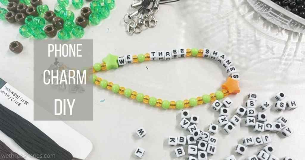 DIY phone charm strap is an easy craft that looks great on your phone and helps protect it from drops. Learn how to make one by following this step-by-step tutorial. | We Three Shanes