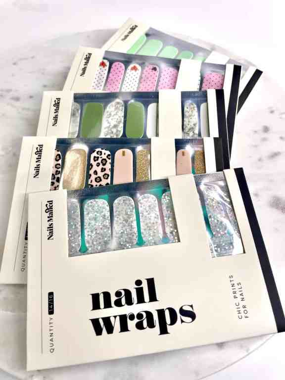 Nails Mailed has a huge selection of cute nail strips for only $5.49. Pictured here are a solid mint, pink and white polk-a-dot with a heart on the tip, solid sage and marble sage and white set, a gold glitter with cheetah accent set, and chunky silver glitter set. | We Three Shanes