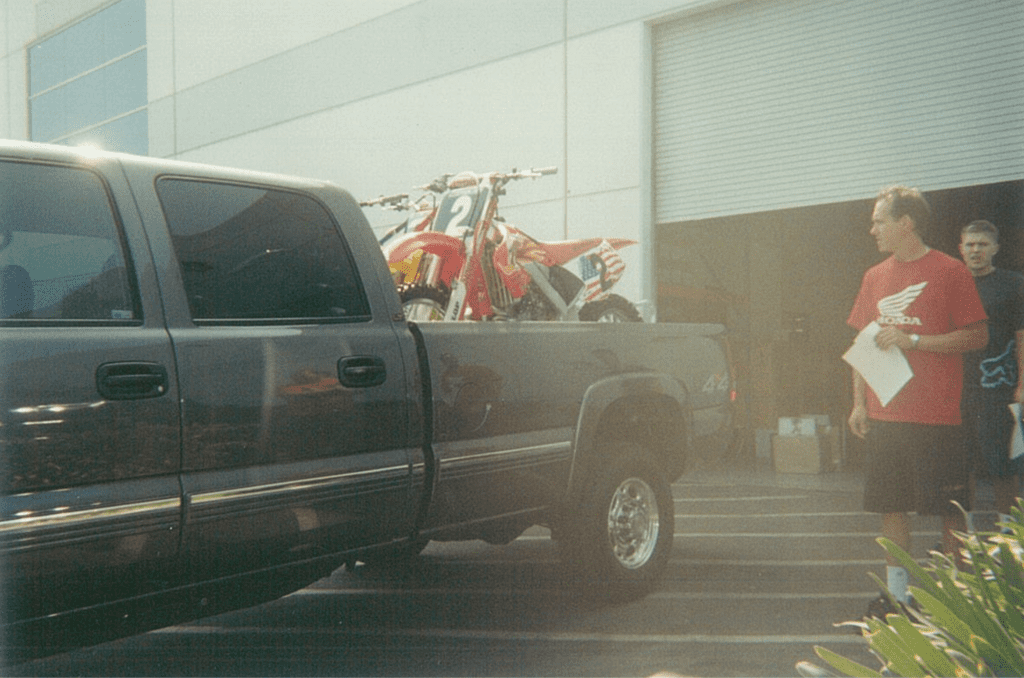 Chad Watts inspects his cargo before driving the three unridden des Nations bikes to a photo shoot with Kinney Jones - Mitch Payton Photo