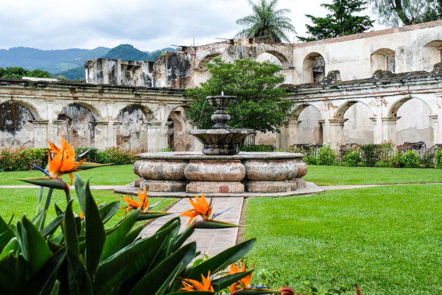Inner courtyard of Santa Catalina Monastery with a fountain and beautiful flowers. Antigua Guatemala.