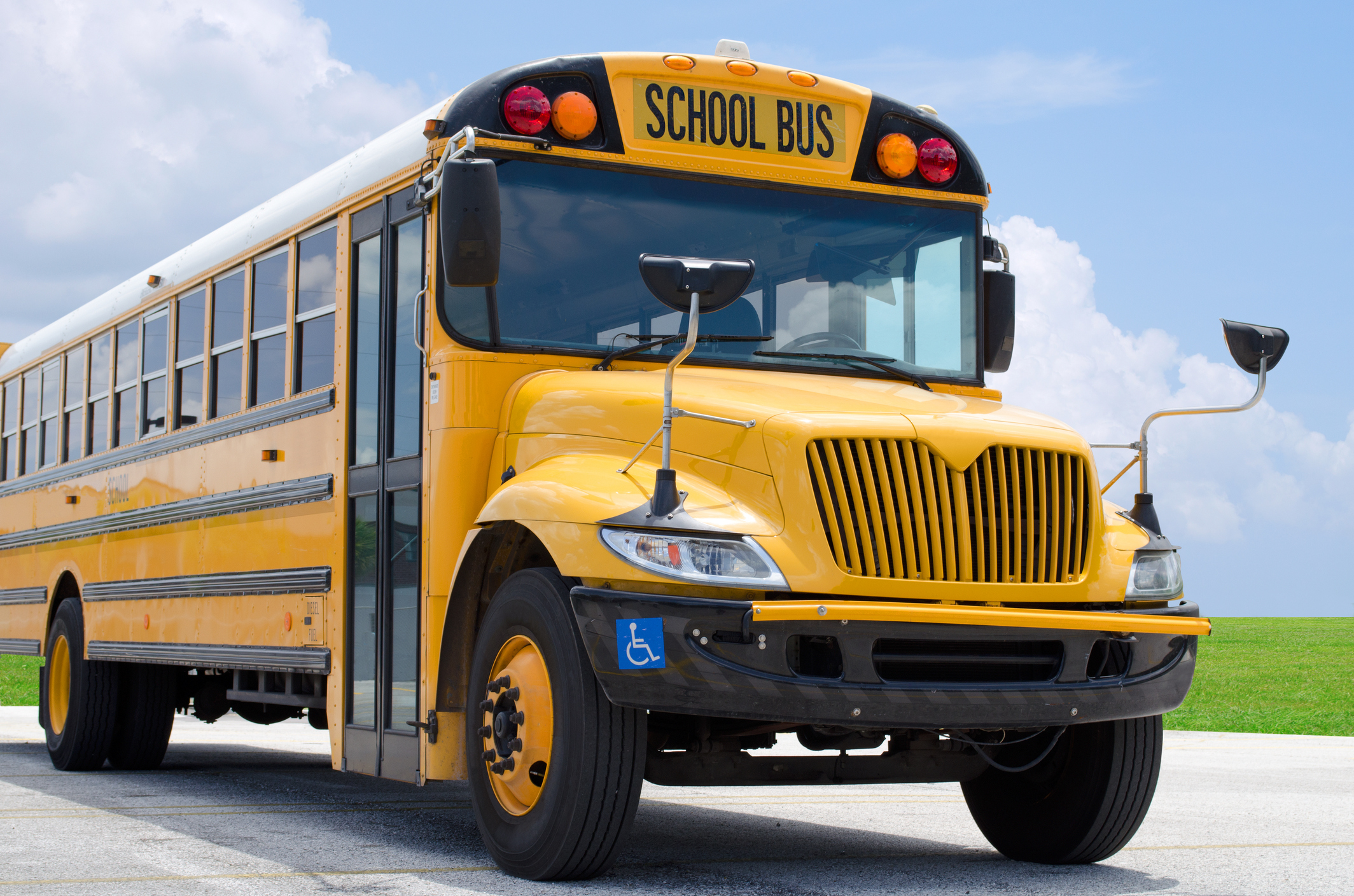School bus on blacktop with clean sunny background_256456