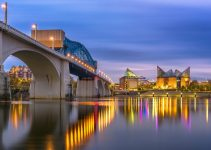 Chattanooga, Tennessee, USA downtown skyline on the Tennessee River at dusk.