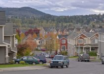 Family homes and vehicles parked in a neighborhood Gresham Oregon.