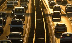 Heavy morning city traffic/congestion concept - cars going very slowly in a traffic jam during the morning rush hour.