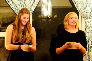 Two members of The Poem Store, Natalie Fedak (L) and Erica Reed compose poetry on the spot at poetrynight. Photo credit: Gary Wade.