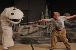 "Sandy Brewer faces off with a sock puppet in ""Kill Me Now"" written by Mathew Thomas Williamson. The sock puppet costume was made in 2013 season by Shu-Ling Hergenhahn-Zhau. Photo credit: Tad Beavers."