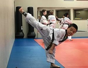 High kicks and lots of focus make for a vigorous practice. Photo credit: Dondi Tondro-Smith.