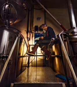 Baggan captured Aaron Jacob Smith-- Head Brewer at Boundary Bay Brewery. Patrick wants to know what it looks like to work in every industry he can manage to peek into. Photo credit: Patrick Beggan.