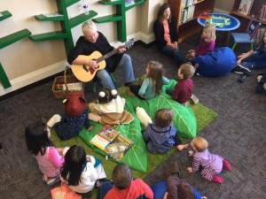 Children of all ages enjoy Pam Sinnett's engaging repertoire of songs at the Bellingham Family Partnership Program library. Photo credit: Dondi Tondro-Smith.