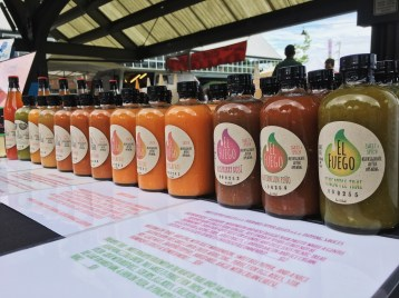 Colorful Pepper Sauces line up in all natural rainbow colors. Photo courtesy: El Fuego Pepper Sauce.