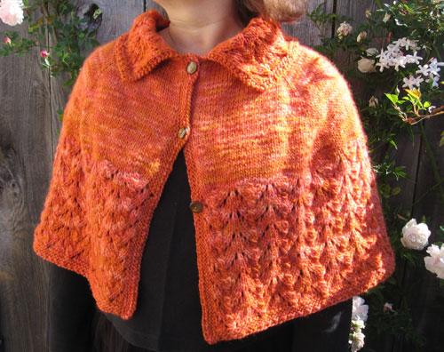 The lovely orange shrug, front view
