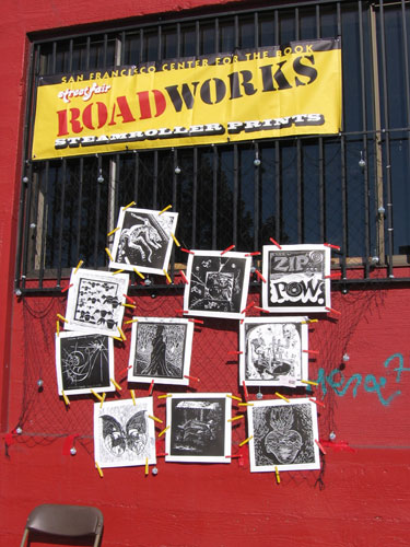 roadworks sign with prints