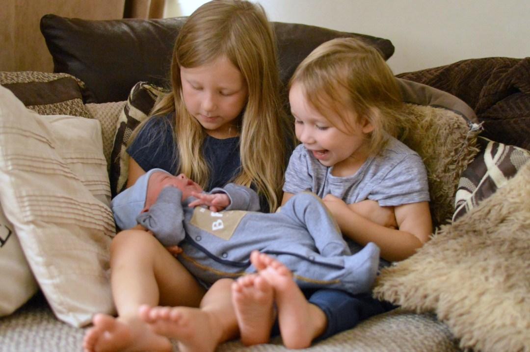 Girls meeting baby