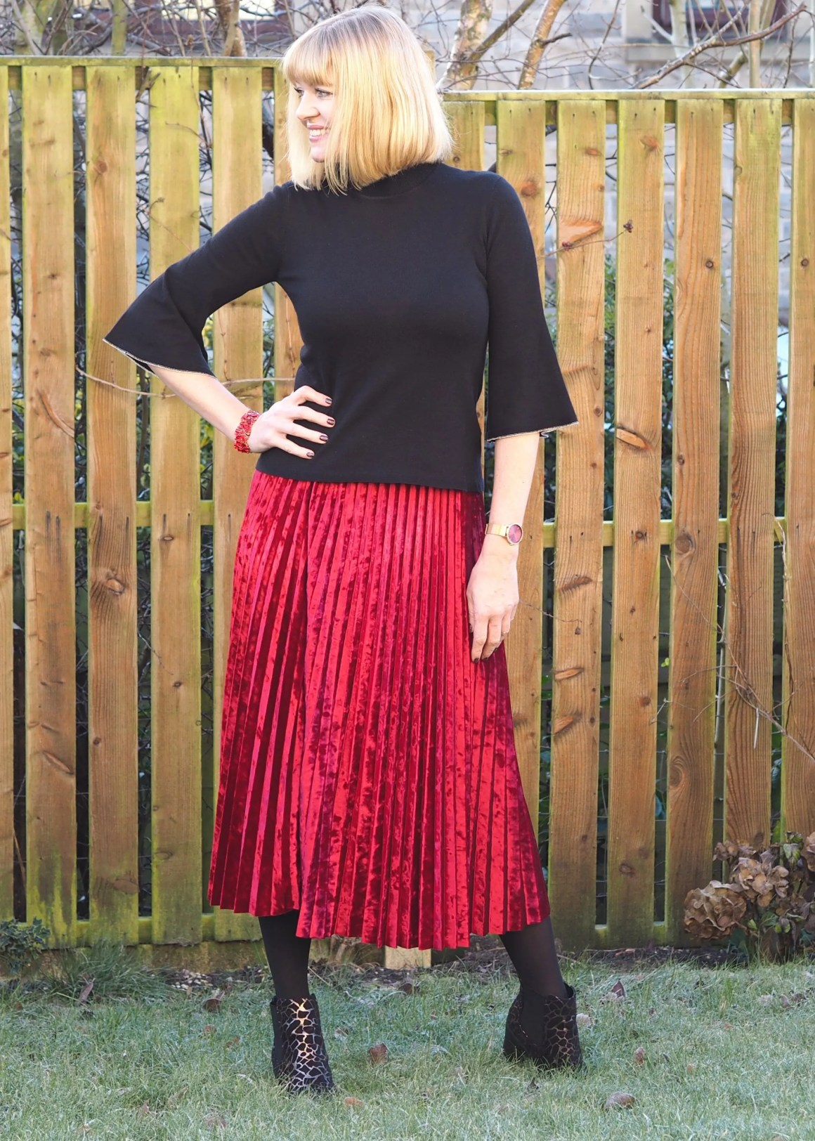 What Lizzy Loves red velvet pleated skirt and metallic ankle boots