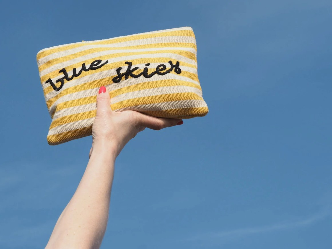 what lizzy loves blus skies yellow striped pouch