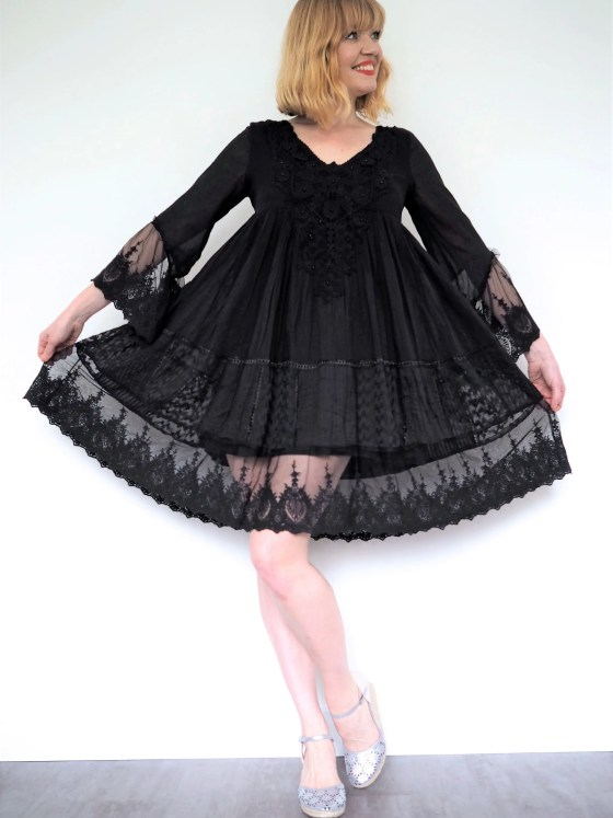 what lizzy loves black iconique cadiz dress neutral holiday wardrobe