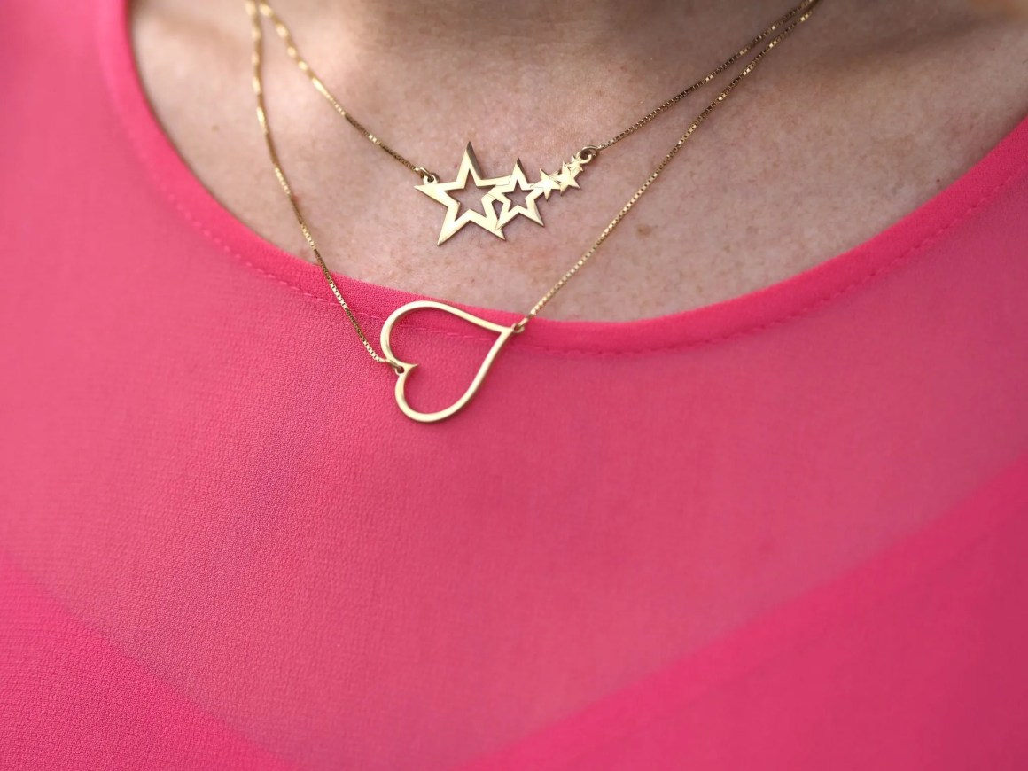 gold sideways heart necklace shooting stars necklace