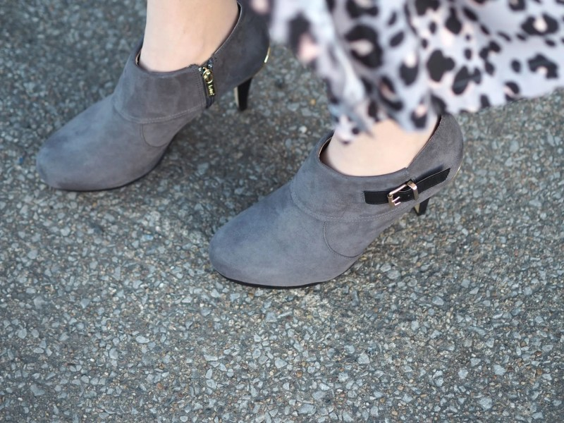 grey high heeled ankle boots and grey leopard dress