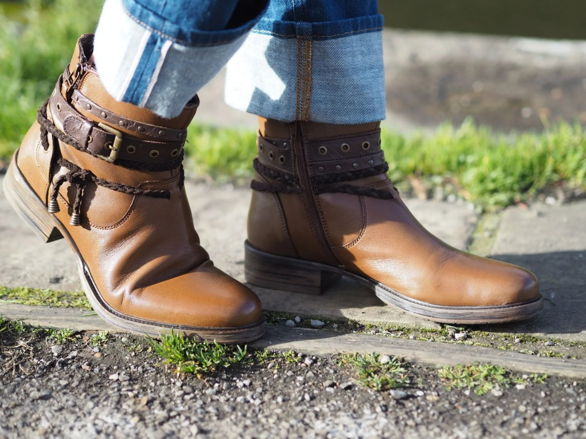 tan leather biker boots with buckles and tassels