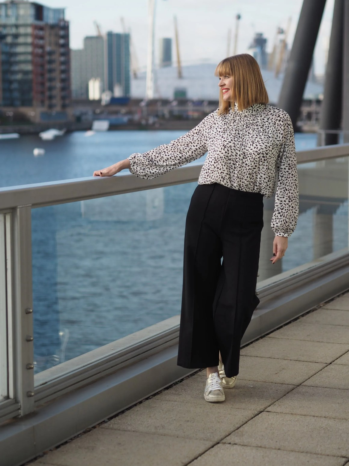what lizzy loves wears leopard print top black ponte trousers gold trainers