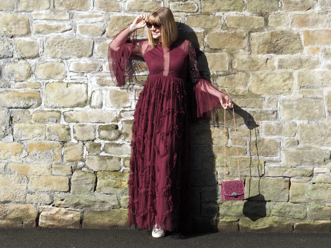 berry rufled maxi dress and square sunglasses