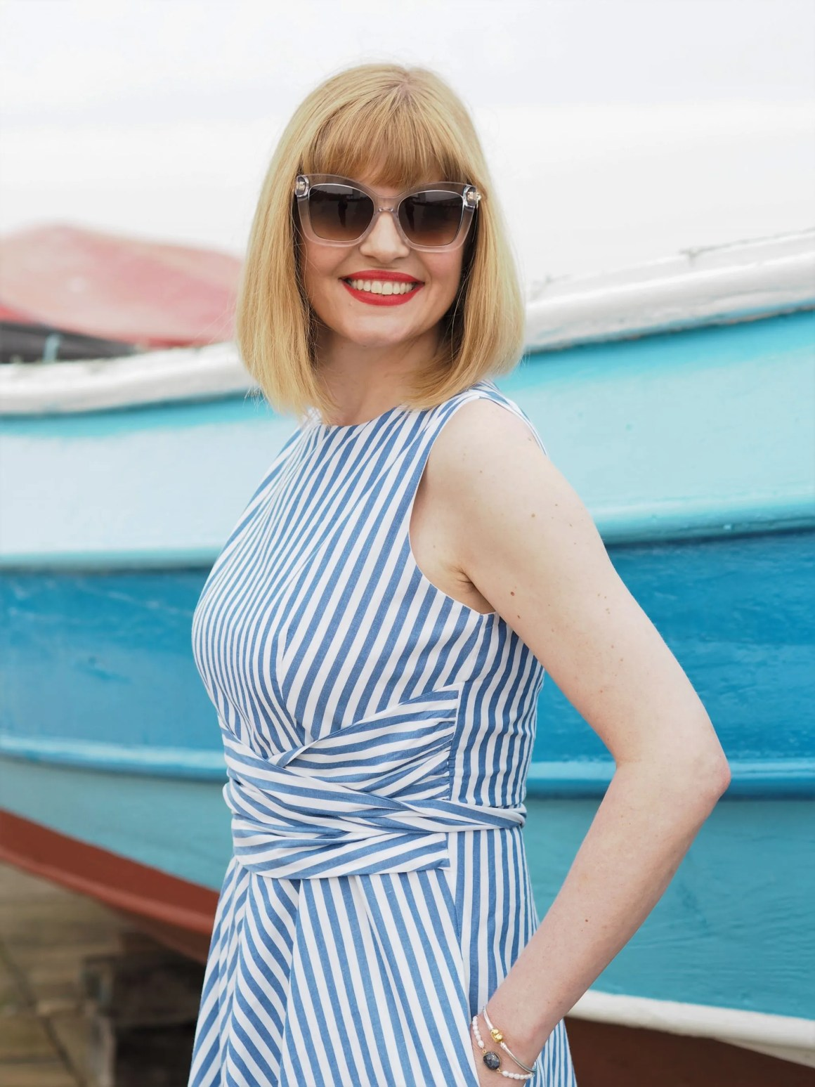 Blue striped 1950s style dress and glamorous cat eye Aspinal sunglasses