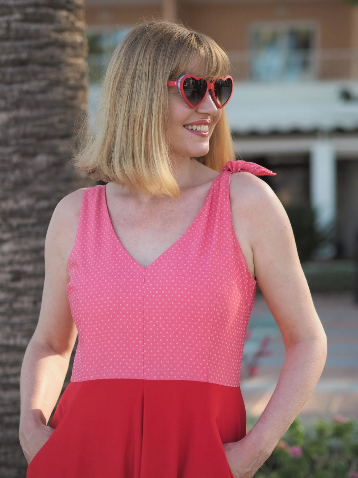 red and pink fifties style dress with red heart sunglasses