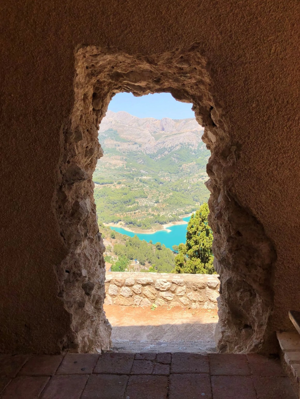 stone archway with view of guadalest reservoir