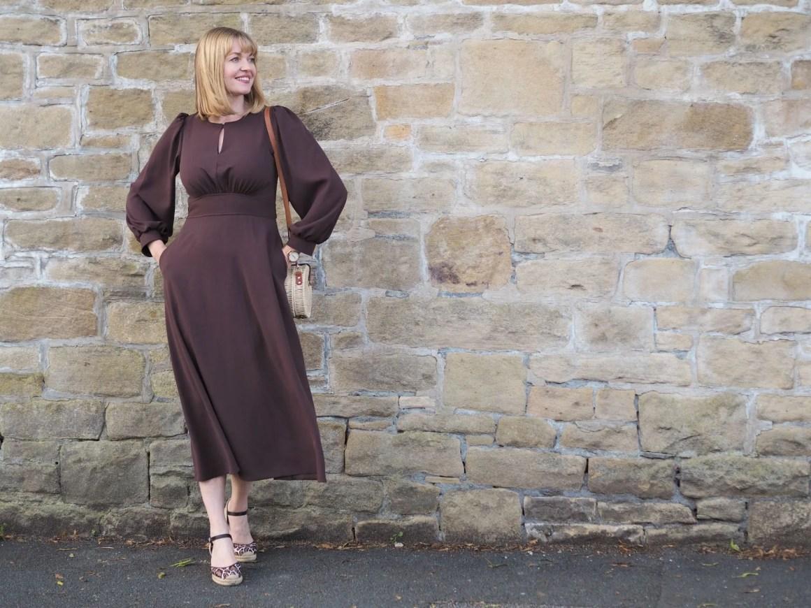 chocolate brown midi dress with puffed sleeves