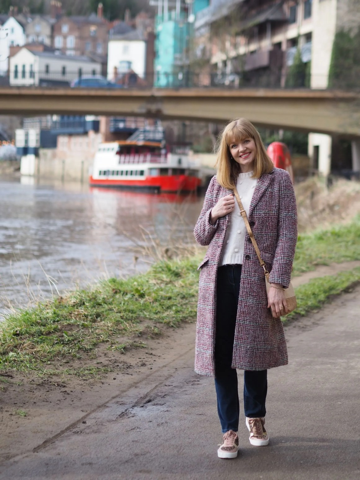 Woman walking by river in Durham